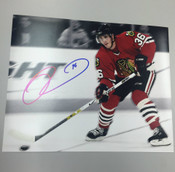 DAVE BOLLAND - Chicago Blackhawks - Autographed 8x10 (Chasing Puck)