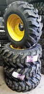 (4-Tires with Wheels) John Deere skid-steer with tire size 12-16.5 12 PR 12165