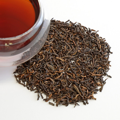 One of the five main types of tea (white, green, oolong and black being the others), pu'erh tea stands apart with its uncommonly soft earthy flavor and woodsy tones. Unlike all other teas, pu'erh (pronounced 'poo-err') is actually aged. The tea leaves go through a natural fermentation process before the tea is gently dried. This creates a cup with zero astringency and deep, rich body. Pu'erh is extraordinarily smooth and deeply refreshing.   Our Pu'erh Poe (the shou variety of pu'erh) gives a clean, woodsy aroma, warm hay inside a barn, mushrooms and savory vegetables.       Wilted flower notes and a faint dark chocolate texture. Mellow and grounding. If the flavor is too strong for you, simply dilute with water (which, interestingly, doesn't work for many other teas.) Pu'erh is extremely versatile - you can steep it for as little as 30 second or 30 minutes, whatever pleases your palate. It won't get bitter and is great for multiple infusions. If you are partial to Pu Erh teas, we suggest delighting your palate with the rich taste of this superior grade tea.