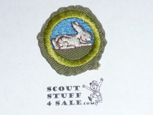 Rabbit Raising - Type E - Khaki Crimped Merit Badge (1947-1960), used