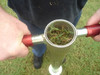 Turf-Tec Tubular Turf Plugger - Plugs fill hollow handle and are stacked on top of each other.  They are ejected out of the open top for replanting