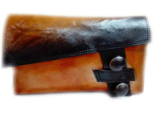 Rachel Rochford X Shoe Lab  Cerro Clutch   Handcrafted black and tan leather clutch with donkey eye detail.  Dimensions: 9 inches x 5.5 inches.