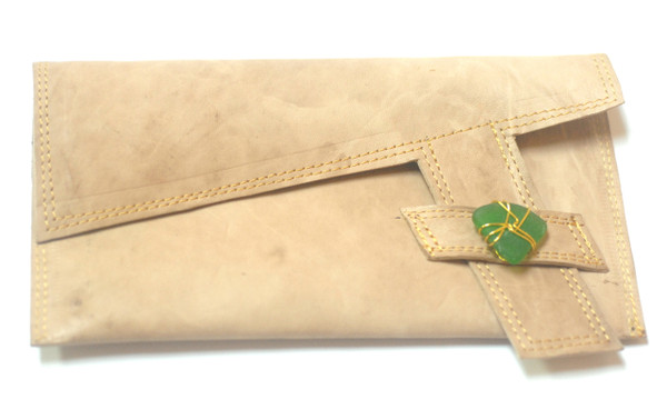 Rachel Rochford X Shoe Lab  Cuevas Clutch   Handcrafted tan leather clutch with gold plated wire wrapped sea glass detail. Dimensions: 9 inches x 5 inches