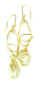 Rachel Rochford. Interlaced gold plated wire with raw clear quartz earrings.