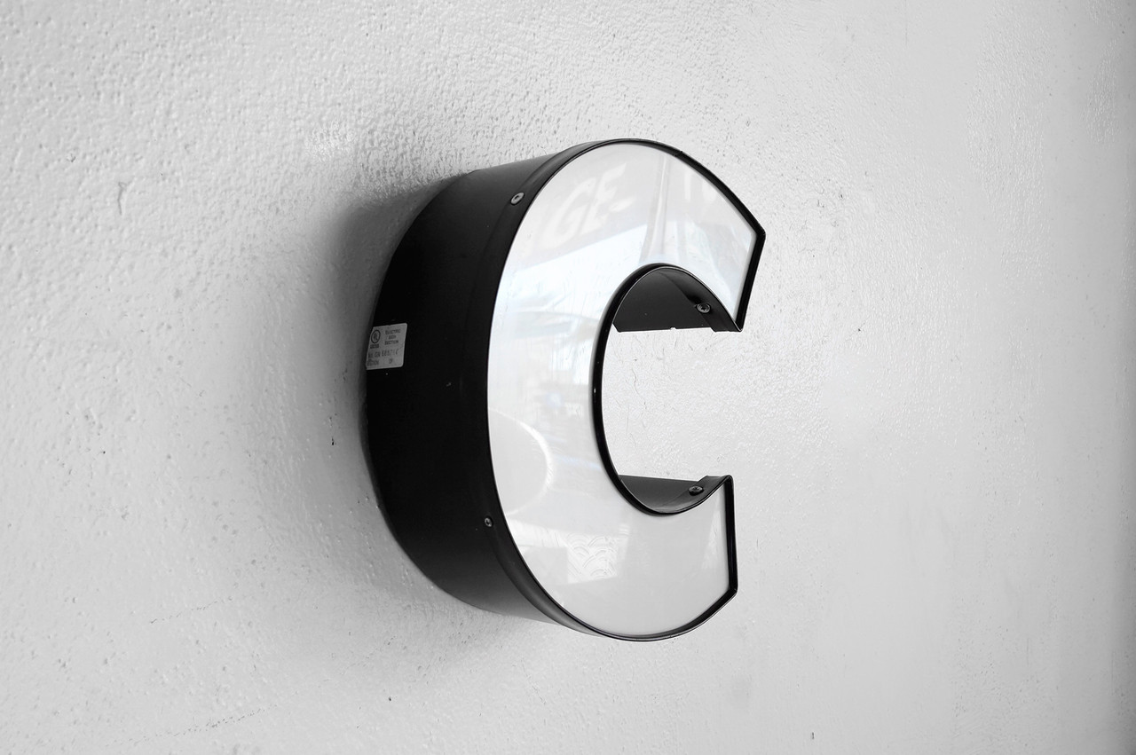 Sold  Vintage Channel Sign Letter C In White Graphic Block Font