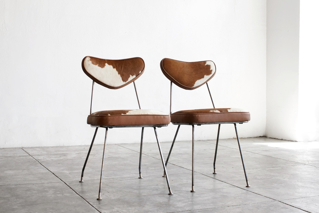 Sold pair of 1950s hairpin side chairs in cowhide for Hairpin cafe chair