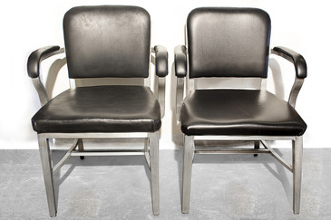 Pair of Emeco Aluminum Solid Back Arm Chairs, 1950s