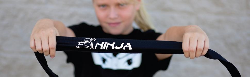 Ninja Girl holding her NinjaZone headband with pride!