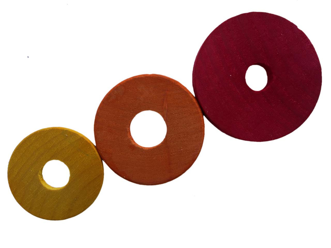 The three sizes of wood washers shown together
