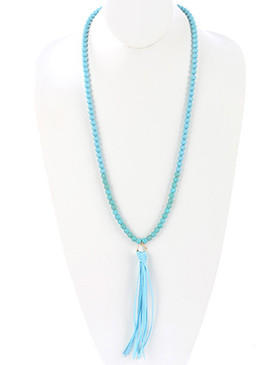 NECKLACE / FAUX SUEDE TASSEL / NATURAL STONE BEAD / HAMMERED METAL RING / 34 INCH LONG / 6 INCH DROP / NICKEL AND LEAD COMPLIANT