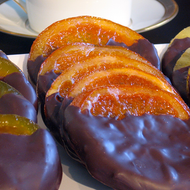 Handmade candied orange slices dipped in dark chocolate by Littlejohn's Candies.