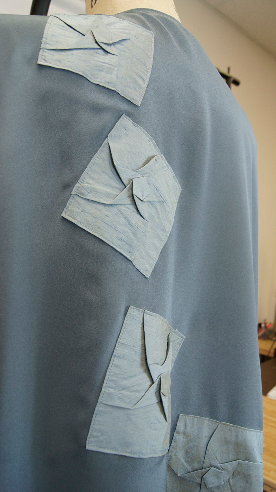 Origami appliques on back