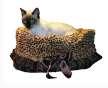 3-In-1 Reversible Cheetah Snuggle Bug functions as a pet bed, a car seat or a shoulder tote.