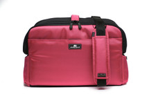 Pink Sleepypod Atom Airline Approved Pet Carrier has storage pockets for travel essentials