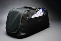 Black Sleepypod Air pet carrier is airline approved for in-cabin flight