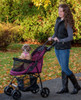 Happy Trails Lite Boysenberry No Zip Pet Stroller fully open with paw rest in use