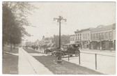 West Union, Iowa Real Photo Postcard:  Downtown Street, Cars, & Dentist