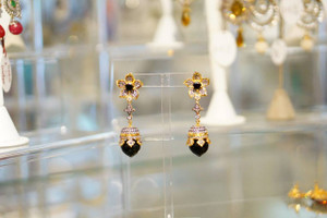 Long earring with black stones