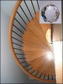 Cure for Spiral Stairways- hang a Crystal at the top.