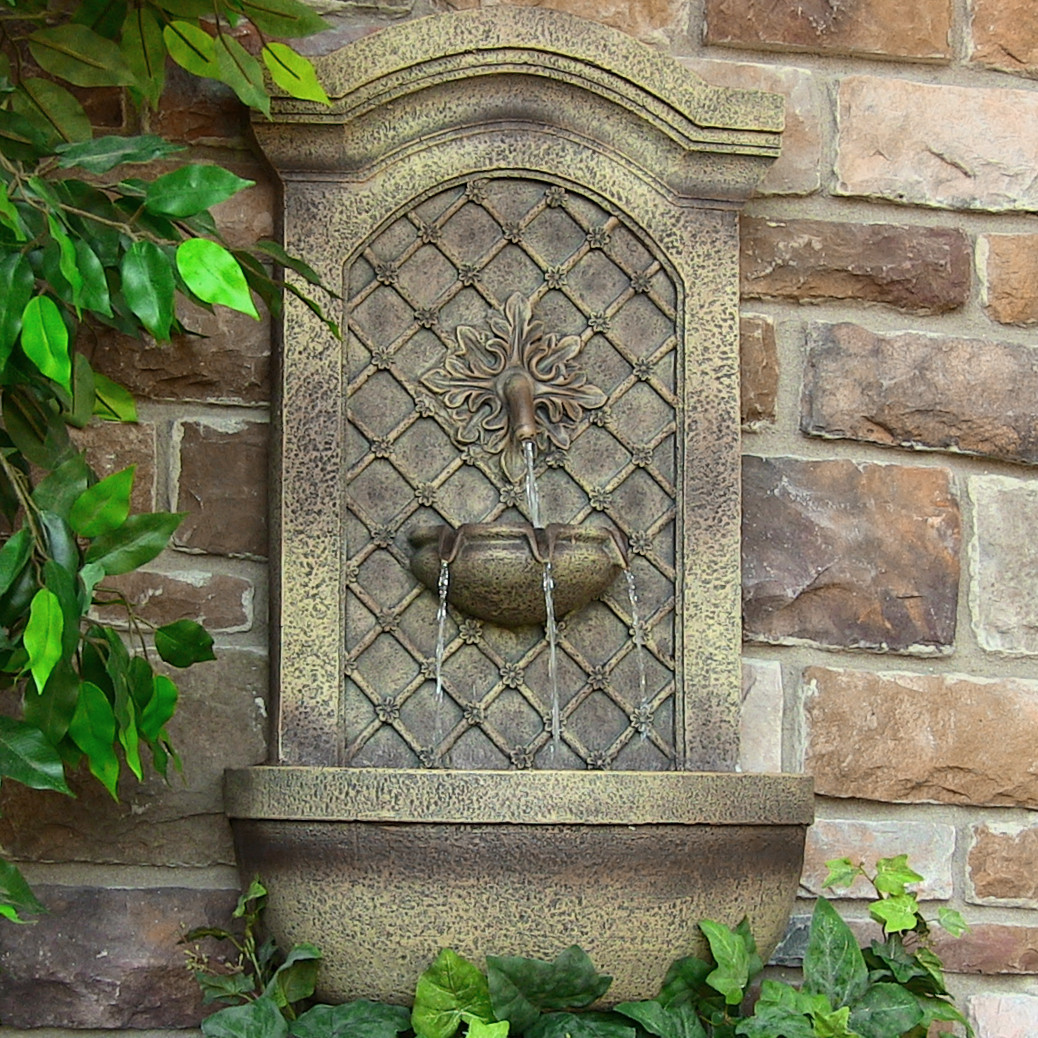 Sunnydaze Rosette Leaf Outdoor Wall Fountain Florentine Stone T Photo