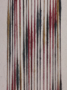 Multi-colored space dyed cotton slub yarn, showing the individual strands