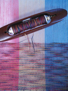 Used as weft on primary color stripes.