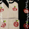 These are raglan tees with red apple monograms.  The black shirt with the apple tee can be found in the back to school section.