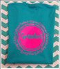 Turquoise tee with hot pink design