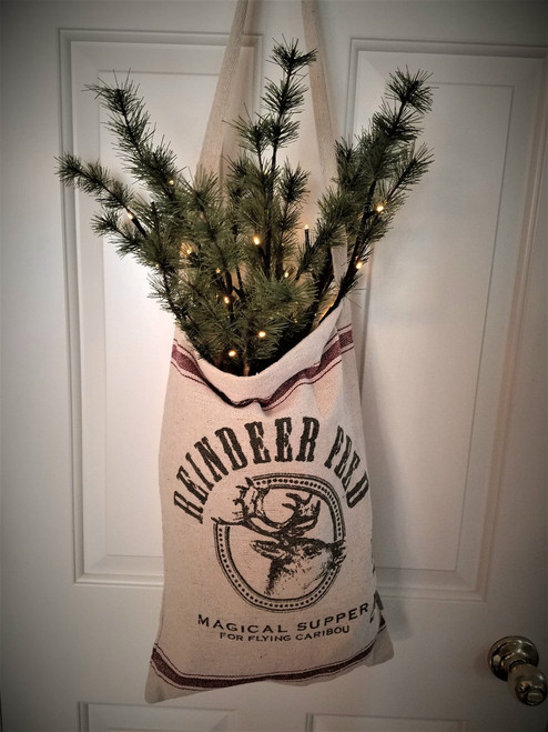 Reindeer Feed Bag With One Stem Pine Twigs, Pre-Lit.