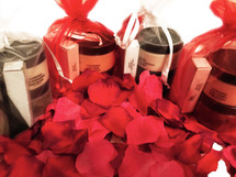 LOVE FEST VALENTINE EDITION:  In this set, we selected our popular small LOVE Fest Gift Set in the scents that remind us of romance.  This set is comprised of some of our most popular products with the idea of luxuriating in a total body experience.     (1) Nourishing Body Butter (4 oz); (1) Based on the Scent Combination you get either the Stimulating Sugar Scrub (4 oz) OR the (Balancing Dead Sea Salt Scrub (4 oz); We paired the Handmade Soap and the Seductive Fragrance Oil to compliment the Body Butter and Scrub selected; (1)  Cleansing Soap (Small 3-4 oz); and (1) Seductive Fragrance Oil.  WHILE SUPPLIES LAST.  PRESENTED IN A LOVELY RED OR WHITE ORGANZA BAG.