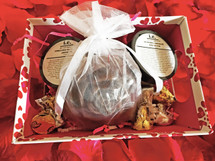 A BOX OF CHOCOLATE GIFT SET:  This one is for all of the chocolate lovers in the world.  Get all of the glory without all of the calories and you will smell good enough to eat.  Its all CHOCOLATE!  This gift set consists of 4 items, beautifully wrapped in the cutest box.    Receive one each of the following items:  (1) Nourishing Body Butter (2 oz); (1) Handmade Soap (Small); (1) Stimulating Sugar Scrub (2 oz); AND (1) Chocolate Kisses.   WHILE SUPPLIES LAST.  LIMITED TIME ONLY.   SPECIAL OFFER:  FREE GIFT BOX.