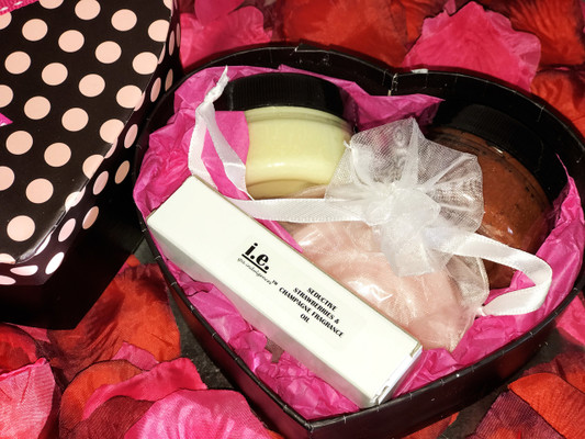 HEART FOR LOVE GIFT BOX:  We picked these items specifically for lovers.  This gift box consists of different items, beautifully wrapped in a heart-shaped gift box to be enjoyed by couples.  Choose either Chocolate or Strawberries and Champagne  STRAWBERRIES AND CHAMPAGNE includes:  (1) Nourishing Body Butter (2 oz); (1) Stimulating Sugar Scrub (2 oz); (1) Seductive Fragrance Oil (.15 ml.); (1) Cleansing Soap (small rose shaped); and (1) Gift Box (Beautifully wrapped with all items inside the box.  Gift box measures 6 x 5 x 3).  WHILE SUPPLIES LAST.  LIMITED TIME ONLY.   SPECIAL OFFER:  FREE GIFT BOX.