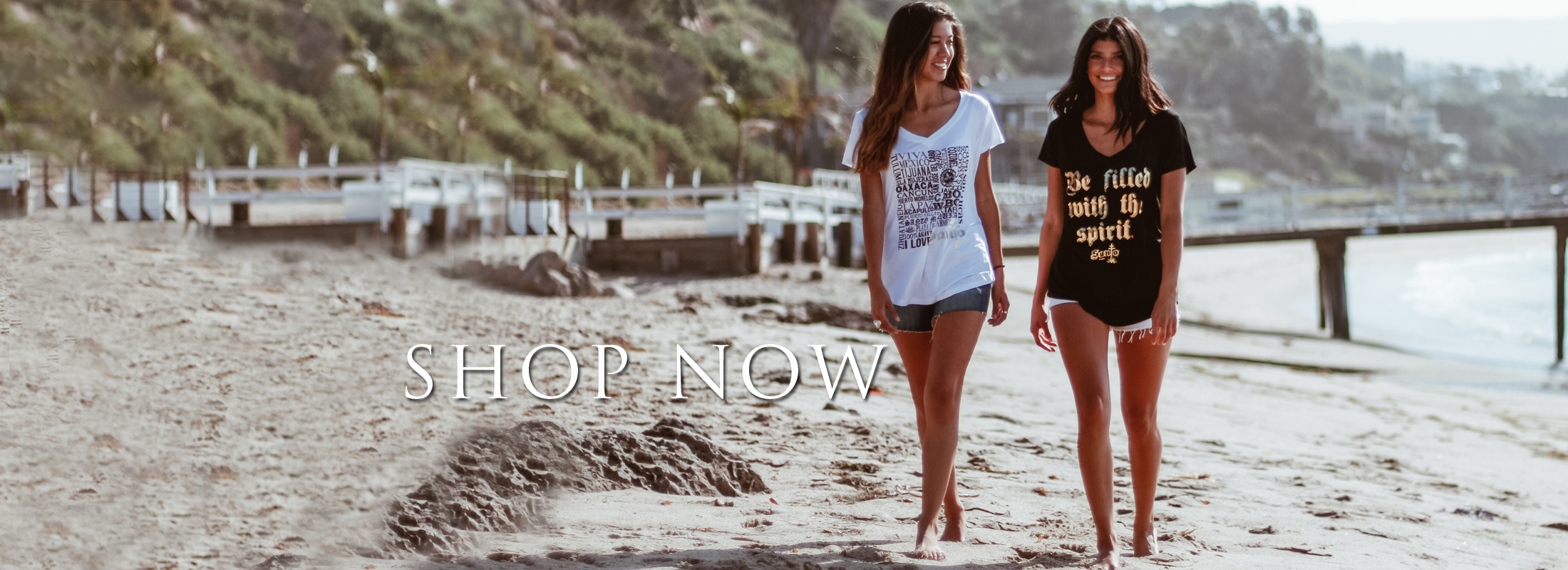 Two girls on beach in Santo inspired tees