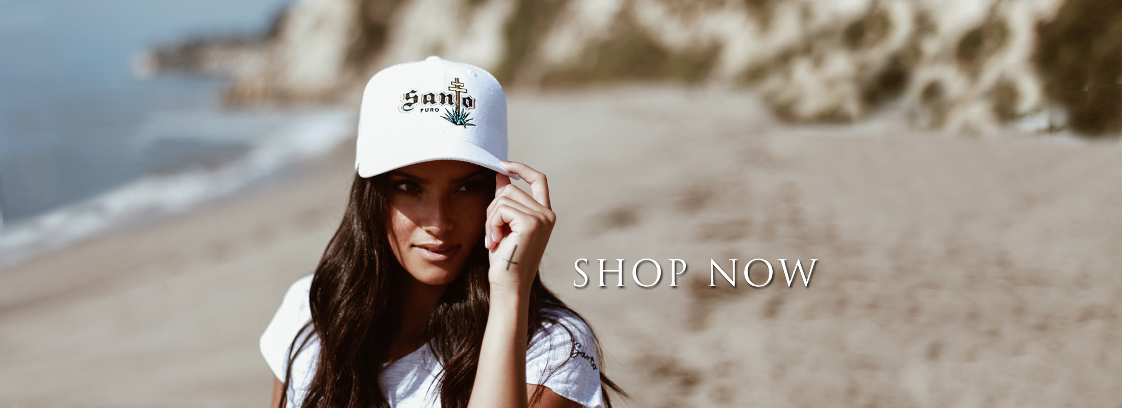 Girl on beach in Santo hat