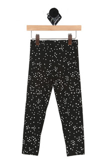 front has elastic waistband with skinny snug fit and black background with mini white stars all over.
