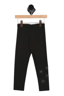 front of leggings has elastic waistband with cluster of black pleather stars at bottom left ankle. Leggings are black.