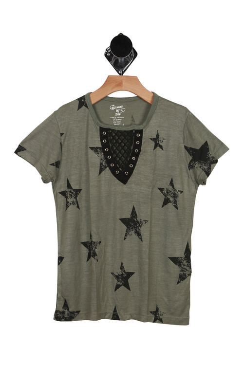 front has short sleeves with olive background and black distressed stars all over. Mesh cutout at neckline