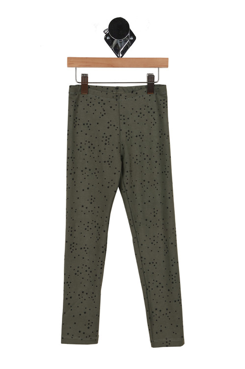 front of leggings has elastic waistband with skinny fit legs and olive green background with mini black stars all over.