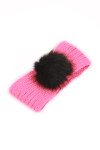 hot pink knit headband with black furry pom pom at front