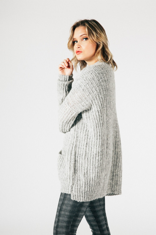 side shows long sleeve heather grey cardigan with plaid black and grey leggings