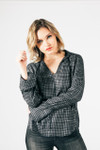 front shows a v-neck line with black and silver plaid material, long bell sleeves and rounded bottom hem.