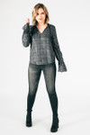 full outfit shows Calissa long sleeve blouse with grey skinny jeans and black boots