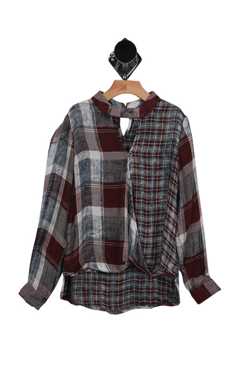 """front has V shape cut out at top with surplice style """"wrap"""" front with long sleeves. Plaid print has purple, light blue & navy in it."""