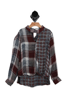 "front has V shape cut out at top with surplice style ""wrap"" front with long sleeves. Plaid print has purple, light blue & navy in it."