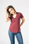 The V-neck tee in dark wine color has short sleeves, classic tee fit and paired with light blue denim.