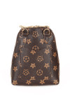 back of purse has pocket and bag is brown with light brown flower print all over.