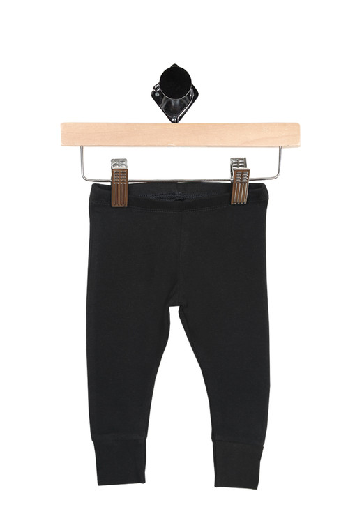 leggings have elastic waist band with cuffed bottom hemline. leggings are all black.