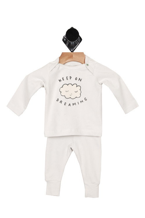 "front shows long sleeve tee with snap closures at each shoulder and ""keep on dreaming"" with white cloud smiley at front. Paired with matching leggings."