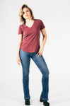 full body view shoes boot cut jeans with light burgundy v-neck tee