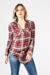 front of blouse shows v-neckline with collar, long sleeves and plaid in burgundy, peach, white & black colors.